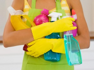 Photo of a lady with cleaning products